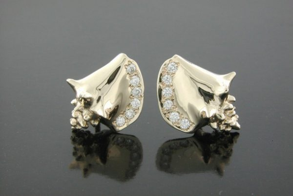 14K yellow gold Conch Shells with .12ct. pave set diamonds. These are friction post back style earrings. Measures 1/2″ high.