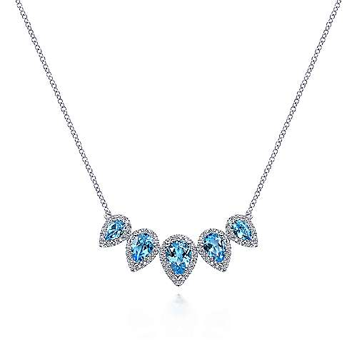 Graduating 14K White Gold Pear Shaped Blue Topaz and Diamond Halo Necklace - designed by Gabriel & Co., New York. Passion, Love & You.