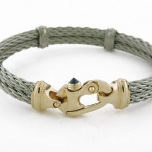 Men's stainless steel double strand neuveau cable bracelet and 14K yellow gold mariners snap shackle clasp with blue sapphire release pin.