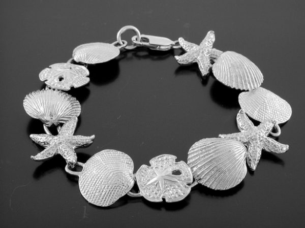 Sterling Silver Mixed shells bracelet, 7.5″ long with lobster catch. All nautical jewelry items are custom made in the U.S.A.