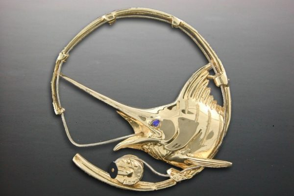 4K Yellow & White Gold Marlin Rod & Reel Pendant with .05ct. Sapphire eye. White gold fishing line with black coral reel handle.