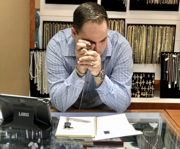 jeweler reviewing jewelry piece, jewelry financing and leasing